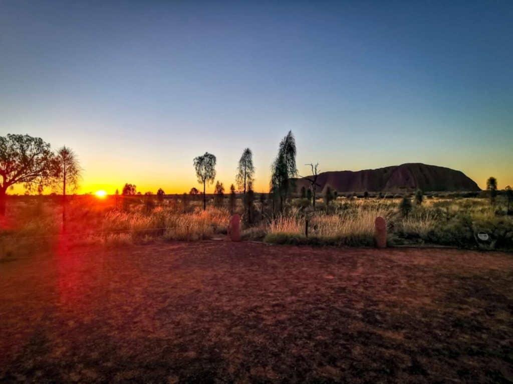 Sun setting behind Uluru/Ayers Rock